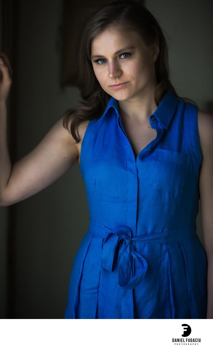 Portrait of woman in blue dress