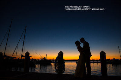 Silhouette of bride and groom by Mantoloking Yacht Club