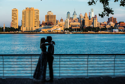 A hug and a kiss in front of the Philadelphia skyline