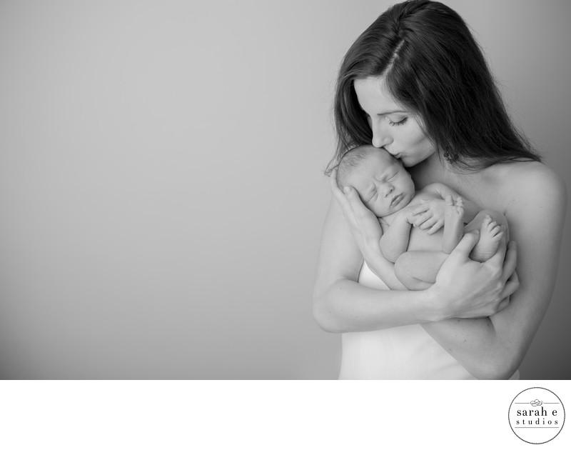 Capture of St. Louis Mom During Studio Newborn Portraits