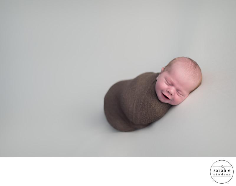 St. Louis Newborn Smiling in Pic