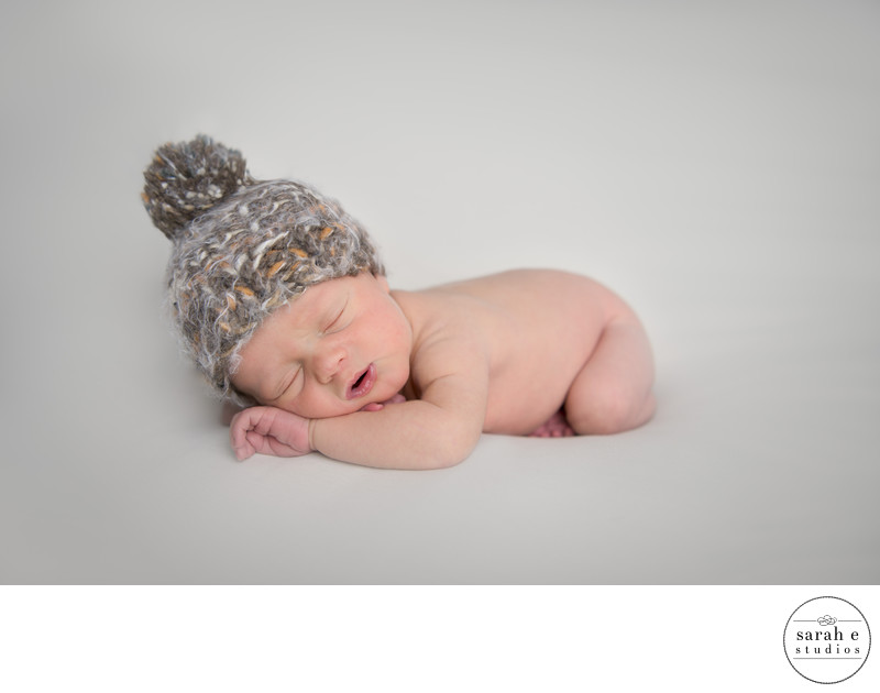 Newborn in St. Louis Wearing a Yarn Hat