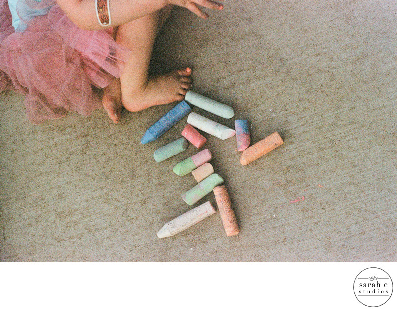 Timeless Pic of Toddler Girl and Chalk in Fil Photo