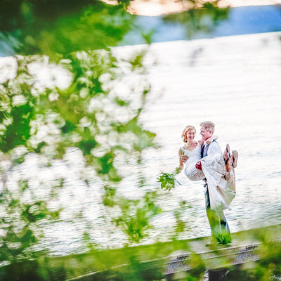 Epic Photo of Bride and Groom on Dock at Lake