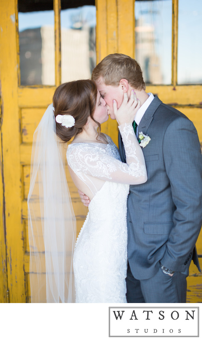 Bride and Groom Kissing in Wedding Photos The Standard