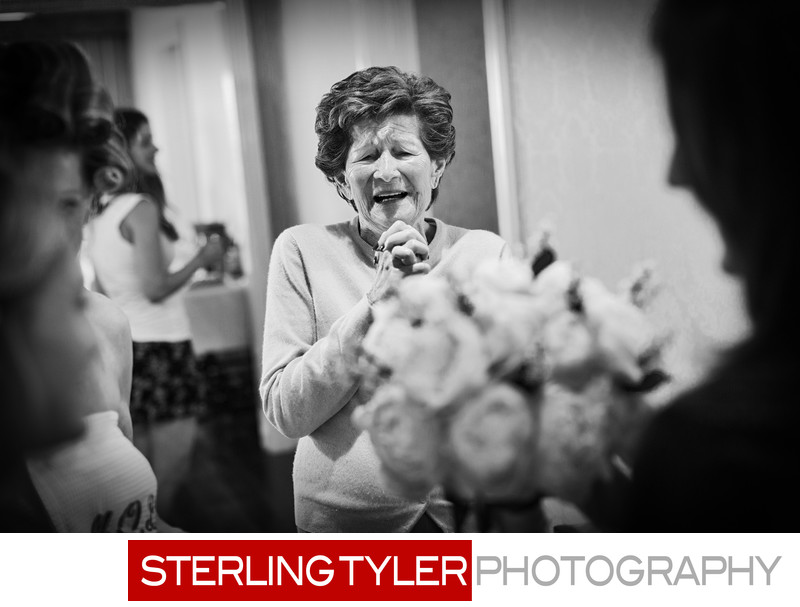 excited grandmother views brides bouquet beverly hills hotel