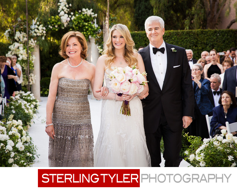 bride with parents walking down aisle crystal garden wedding