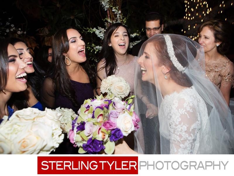 jewish bride celebrates wedding under chuppa