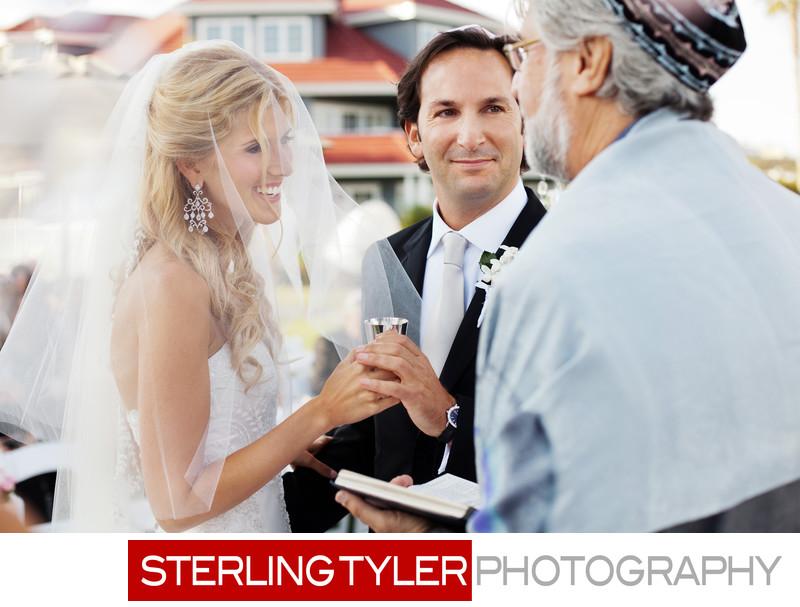 rabbi blesses wine during orange county wedding ceremony