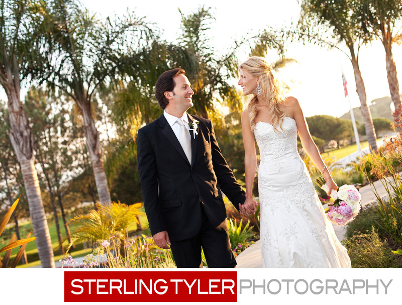 sunset california bride and groom portrait palm trees
