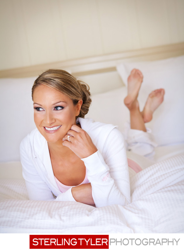 bride laying on bed getting ready wedding photograph