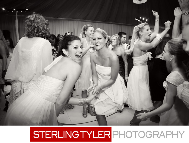 brides maids and bride dancing in tent
