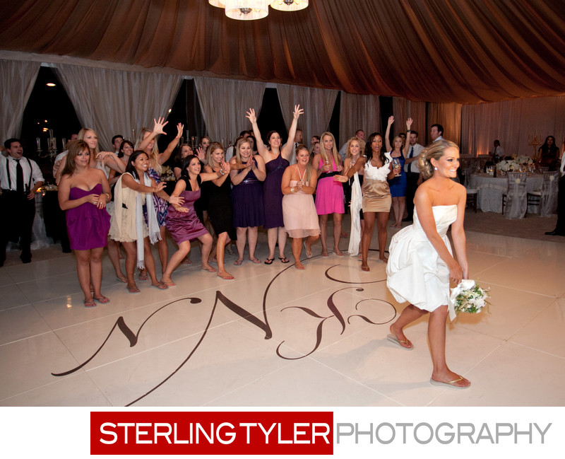 bouquet toss in tent at napa valley wedding