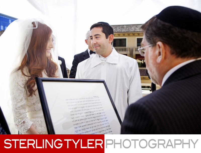 bride and groom with ketubah los angeles wedding photographer