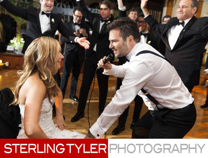 groom sings to bride at jewish wedding