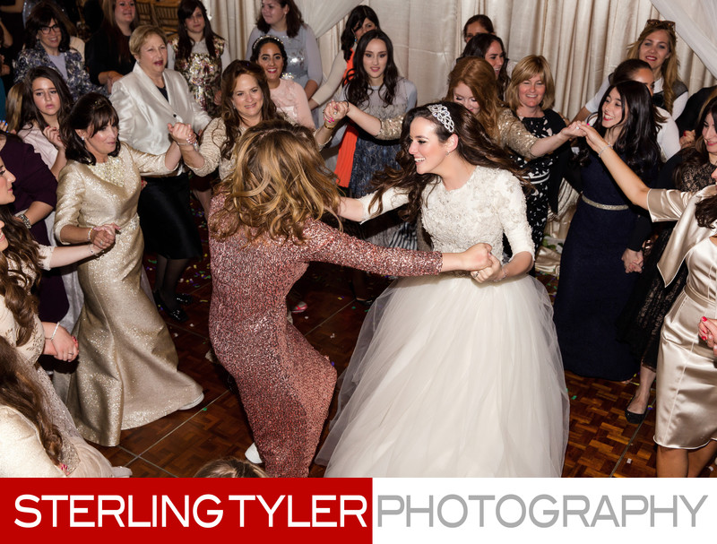 bride dancing with friends at orthodox jewish wedding los angeles