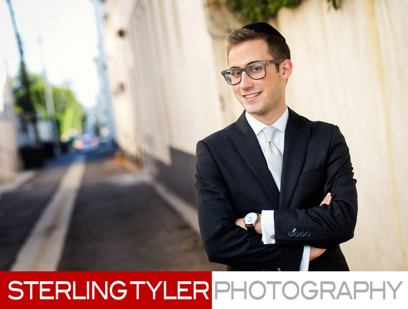 groom poses for photojournlistic portrait in beverly hills