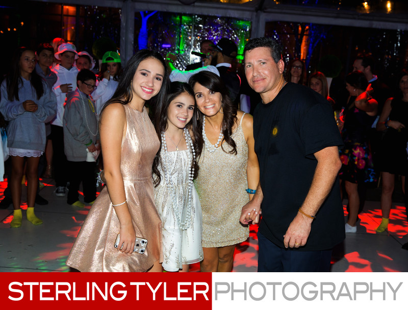 the bat mitzvah with her family at the end of the party