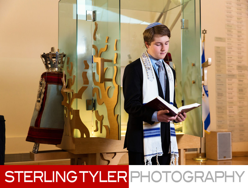 portrait with prayer book and torah at los angeles jewish synagogue