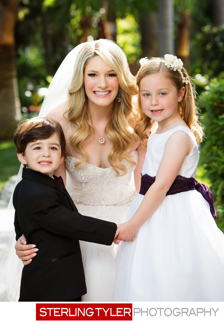 bride with ring bearer and flower girl garden wedding
