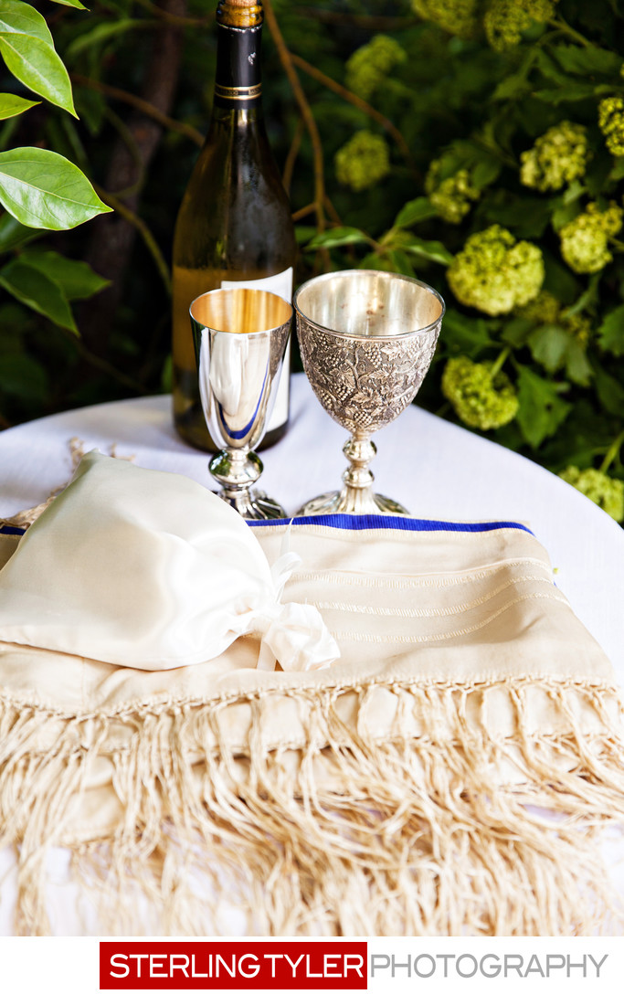 tallis and kiddush cups at jewish wedding photograph