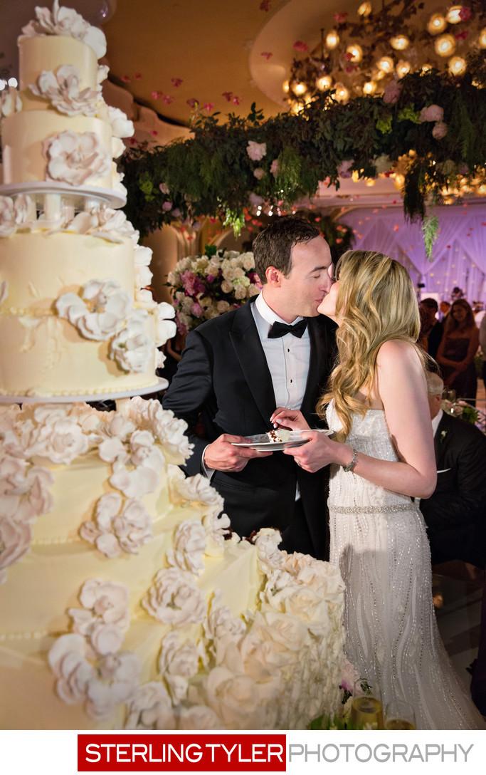 crystal ballroom wedding photography cake cutting kiss