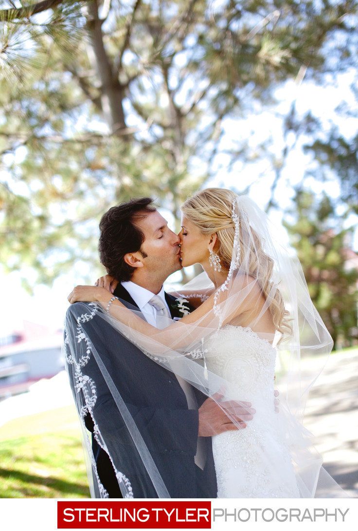 bride and groom kiss with veil la wedding photographer