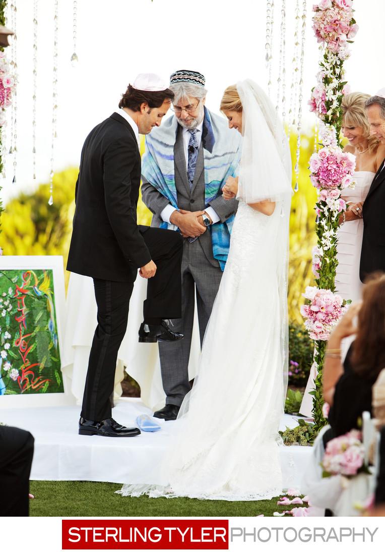 la jewish groom breaks glass during wedding ceremony