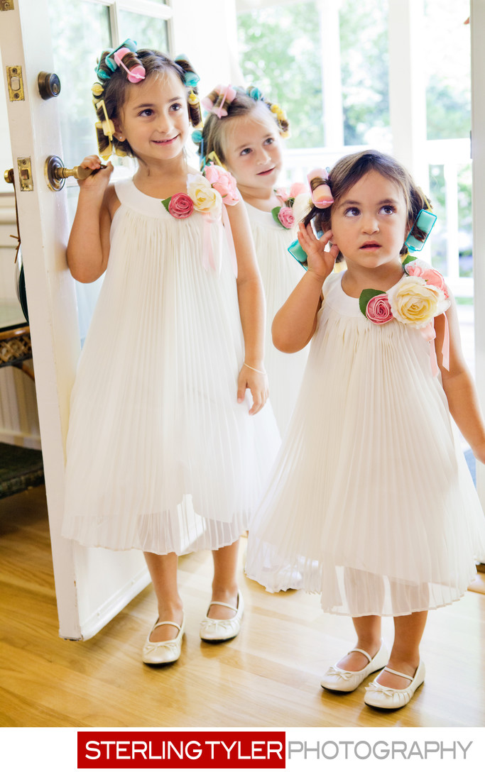 flower girls with curlers in hair candid photojournalism
