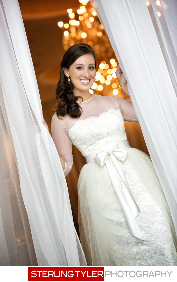 bride in curtains with chandelier at sephardic temple