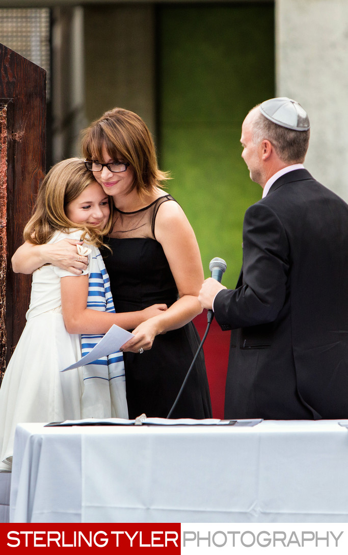 mother daughter hug during bat mitzvah service