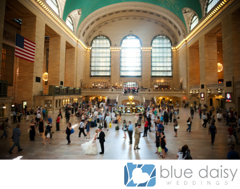 Wedding couple kissing in the crowd in Grand Central