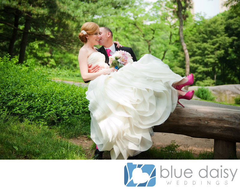 Wedding couple sitting on Central Park bench NYC