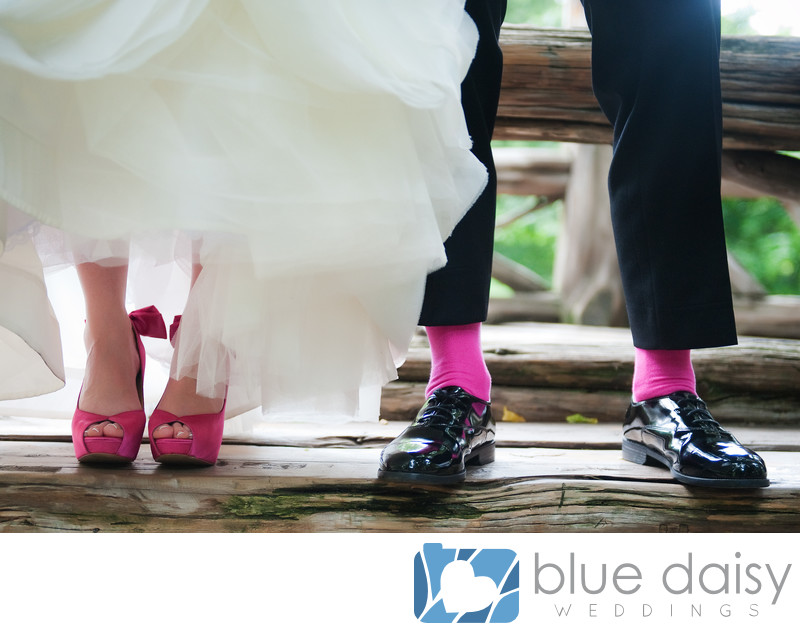 Hot pink fuchsia bridal shoes and groom socks