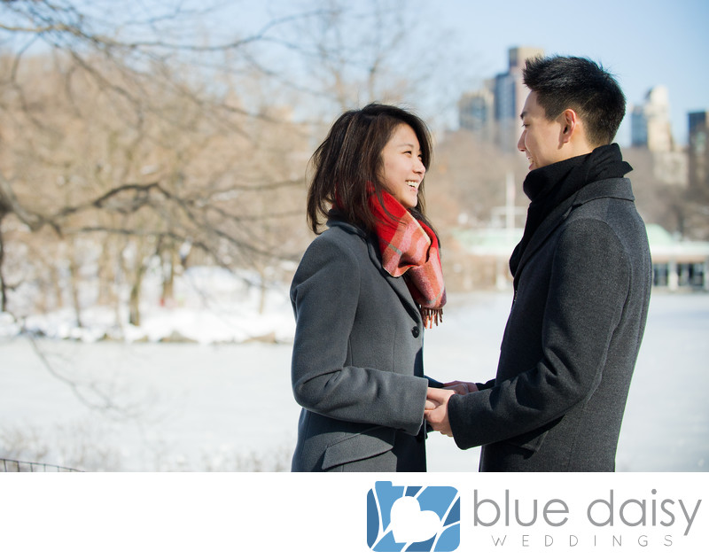 Newly engaged couple in snow covered Central Park