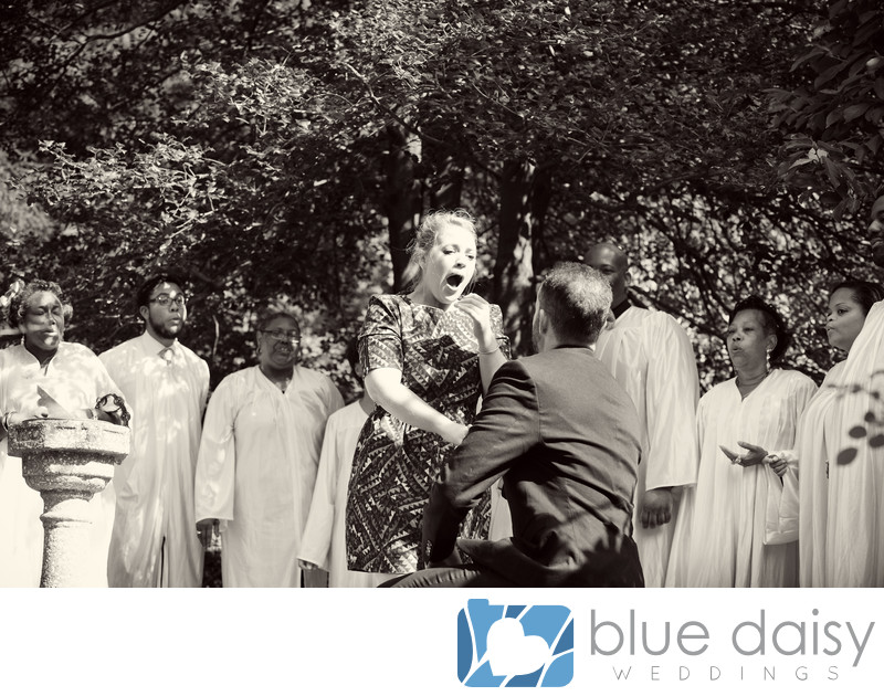 Emotional surprise marriage proposal with gospel choir