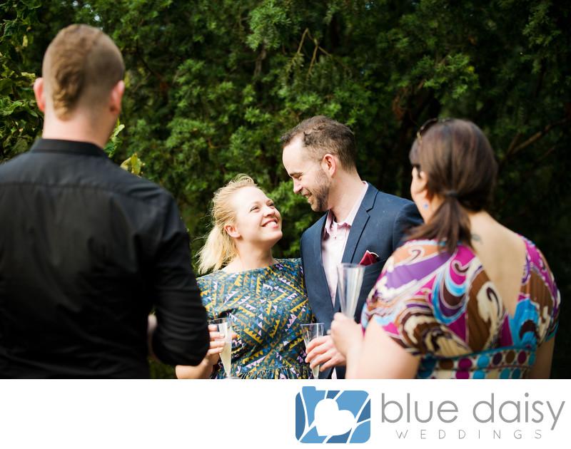 Newly engaged couple celebrating drinking champagne