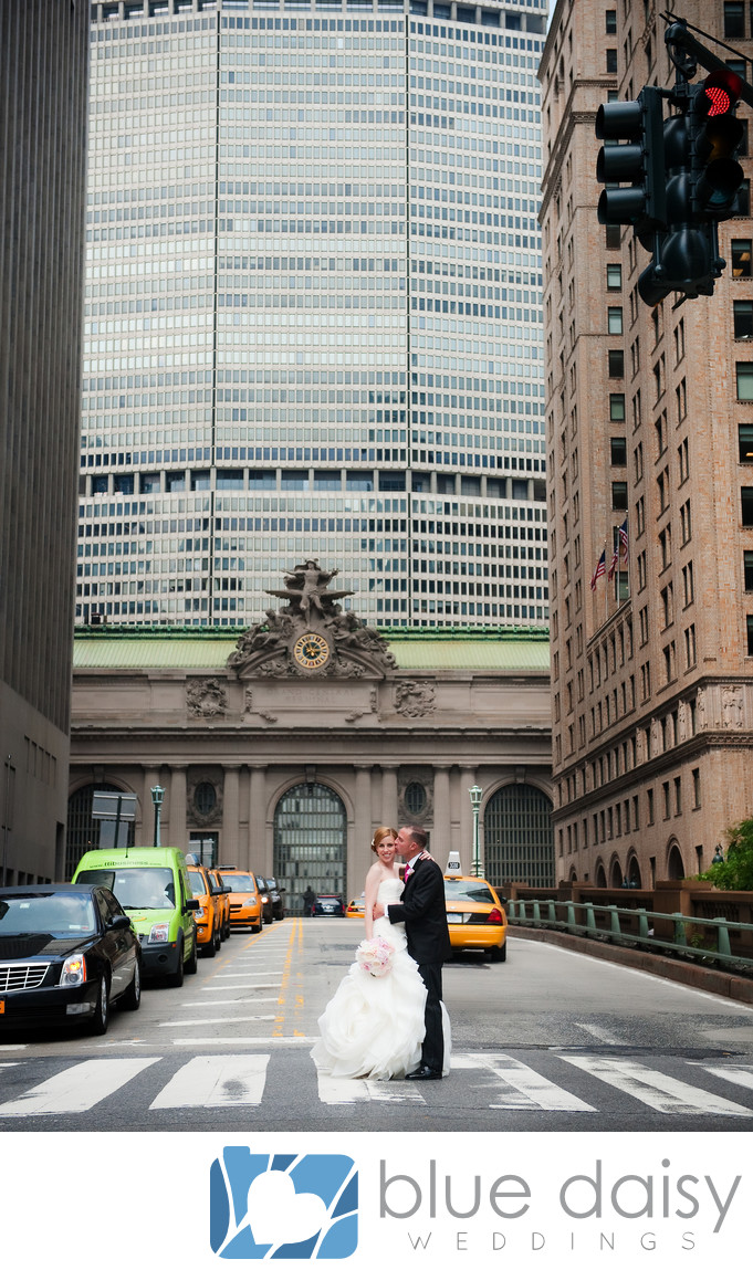 Bride groom standing in front of Grand Central Terminal