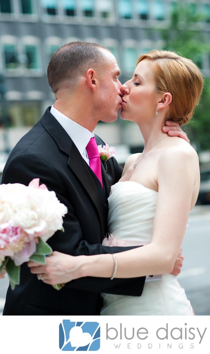 Manhattan wedding couple share passionate kiss