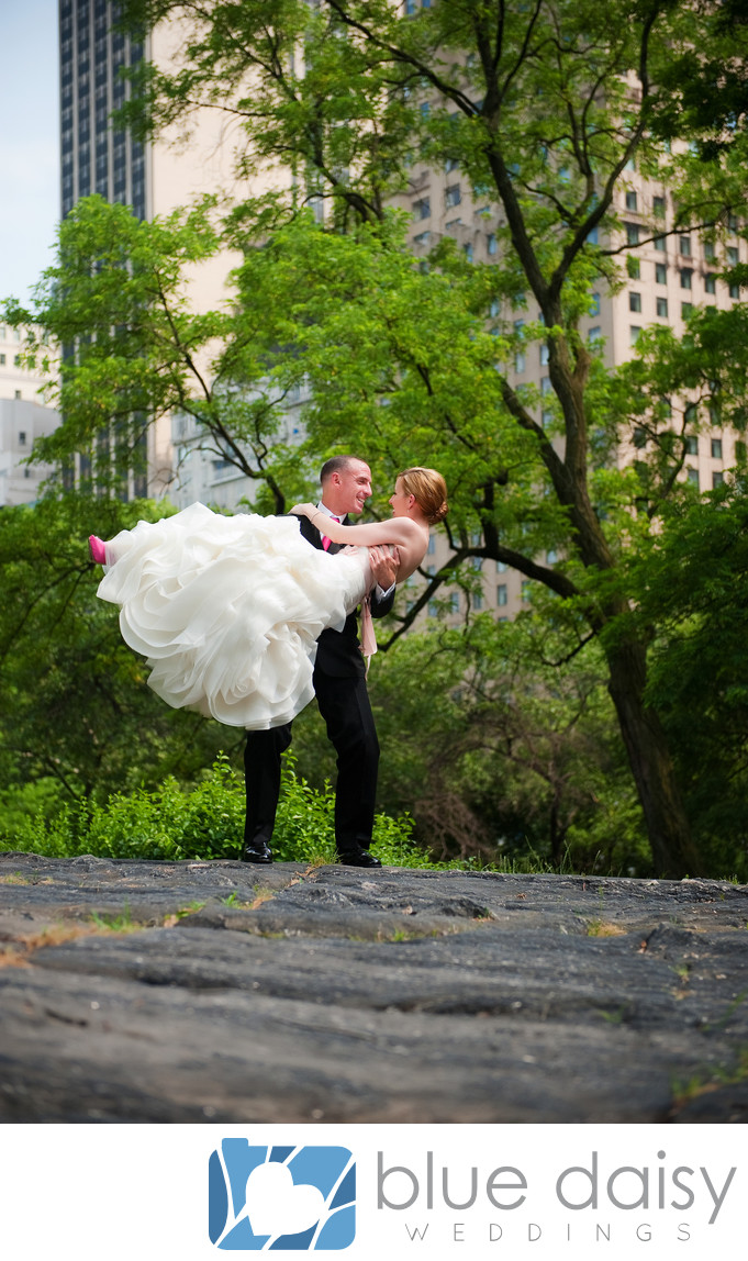 Bride groom standing on rock in Central Park NYC