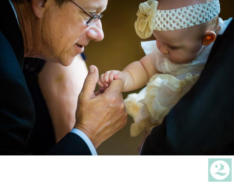 Wedding Baby Grabs Man's Fingers
