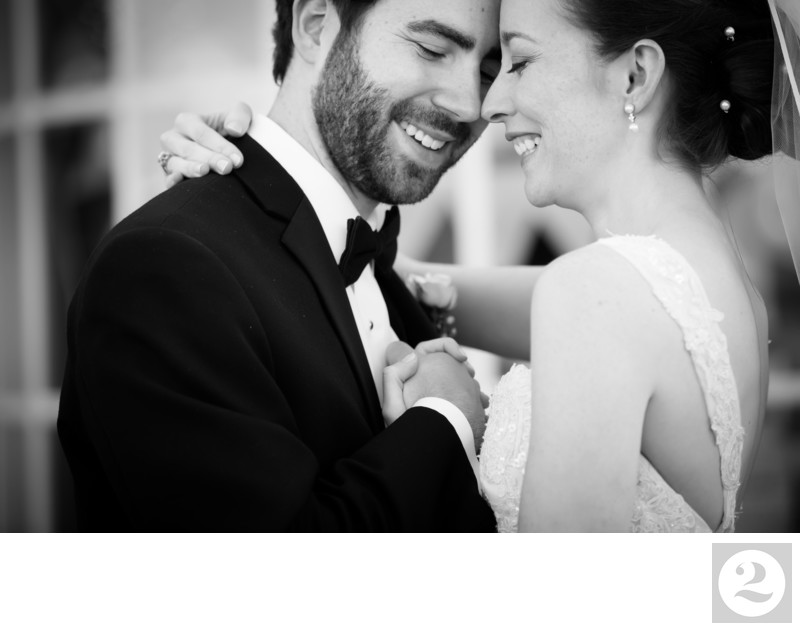 Bride and Groom Snuggling in Black and White