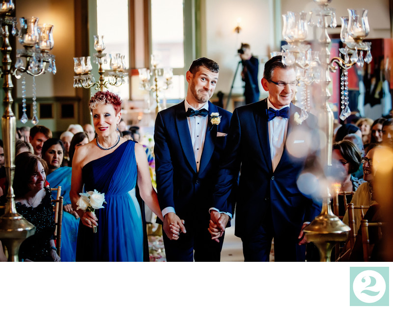 Groom makes silly face down aisle at Germania Place