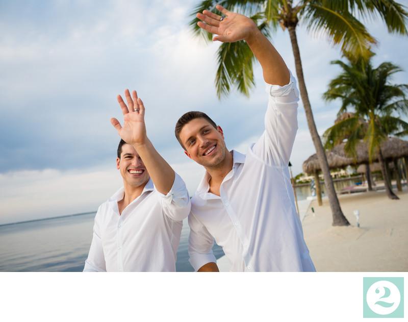 couple waving on florida beach