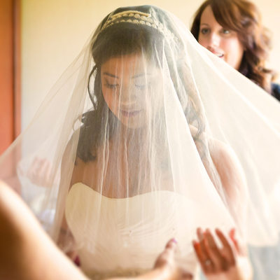 Bride Puts Her Veil on Before the Ceremony