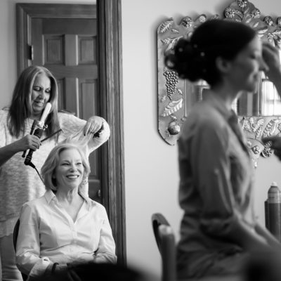 Bride and her Mother Get Ready Together at Home