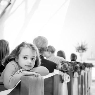 Pensive little girl is a wedding guest