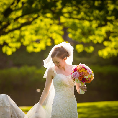 Bride Fixes her Veil in Park's Dappled Sunlight