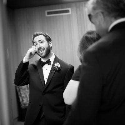 Groom crying before wedding ceremony