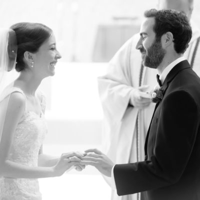 Laughing Bride and Groom Exchange Rings